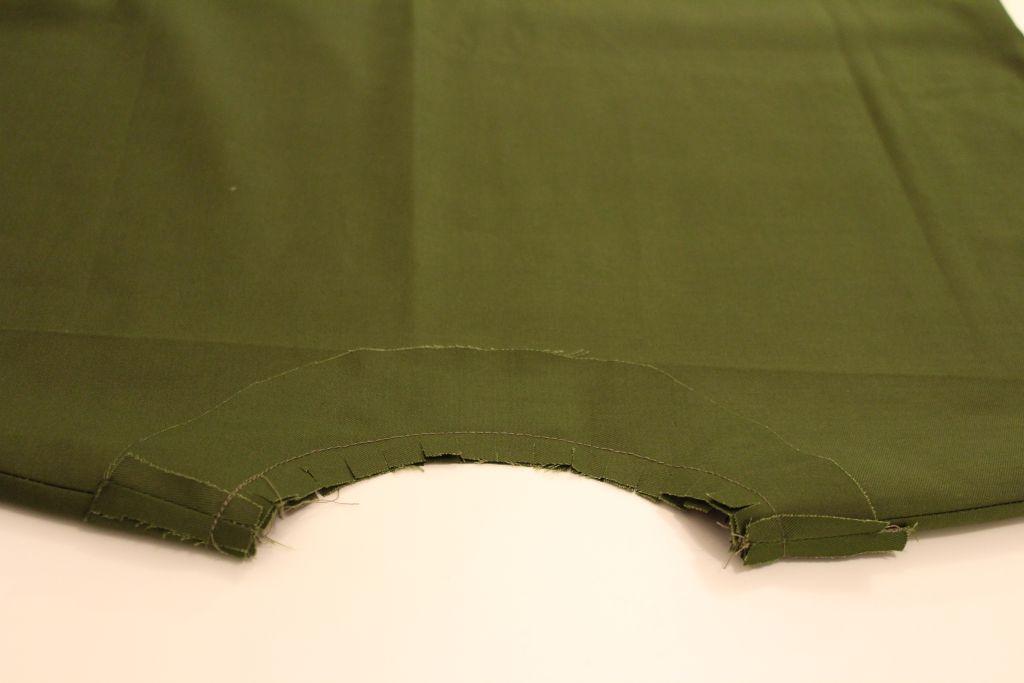 Sew facing to dress