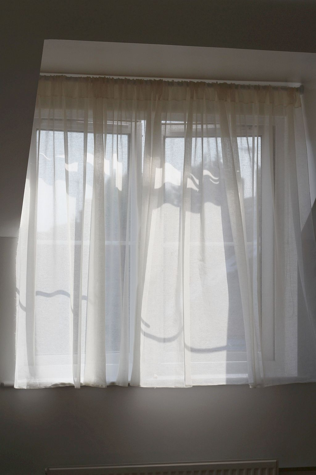 Muslin curtains with a slot