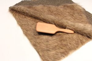 Brush fur inwards on faux fur vest