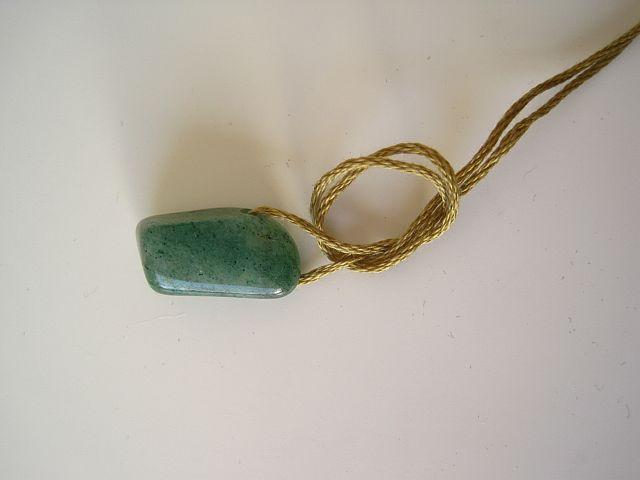 Tie near the stone to stop it sliding around