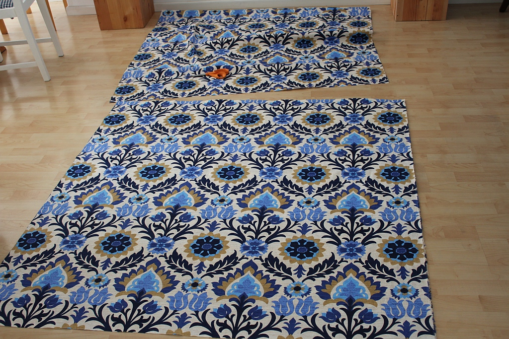 Lay fabric on floor and cut to size