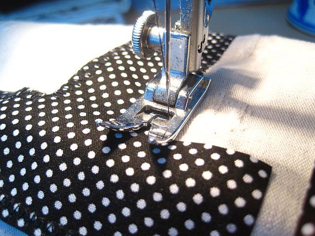 Sew letters onto pocket