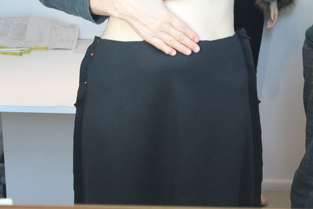 Fit skirt and adjust if necessary