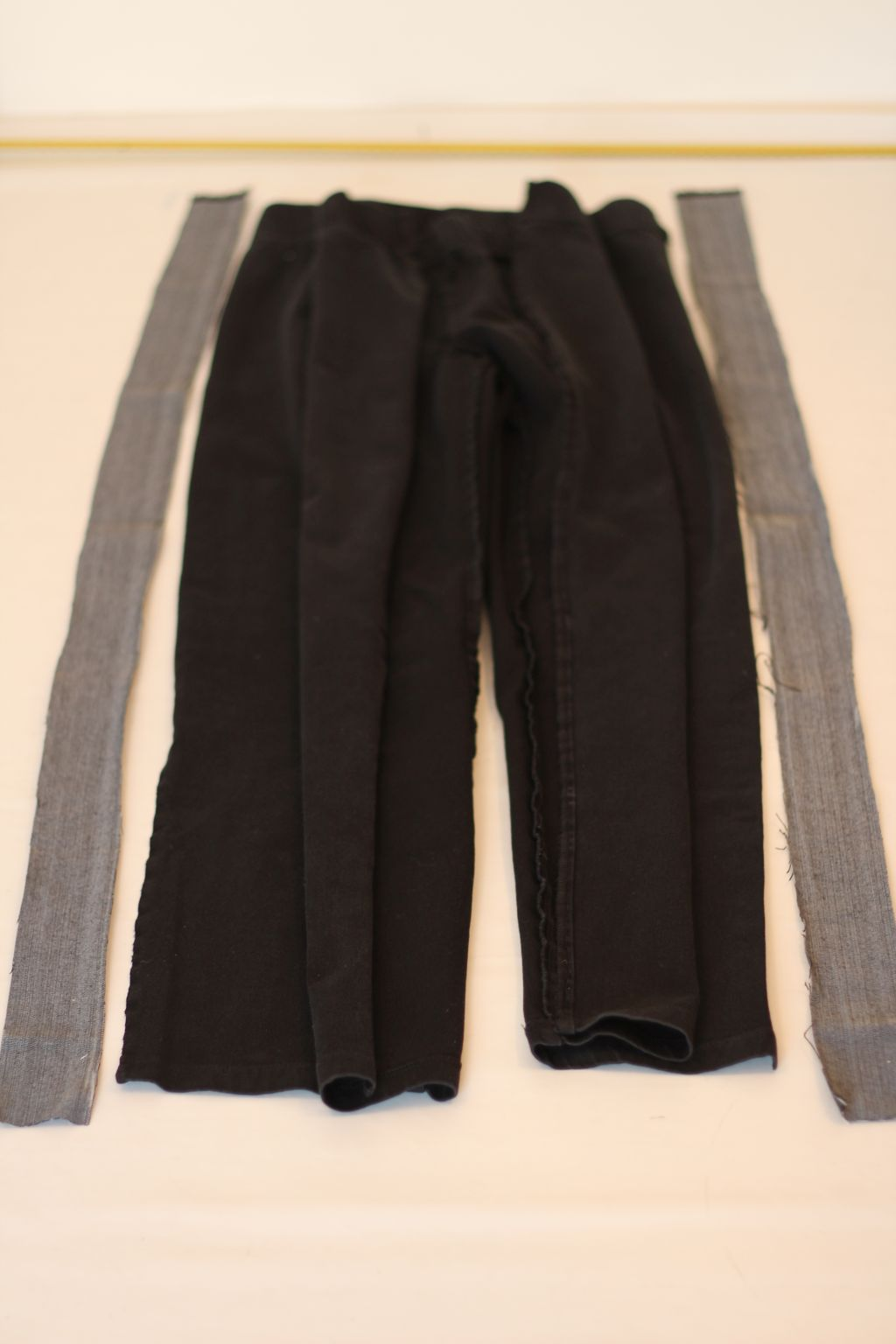 Lay side strips next to pants